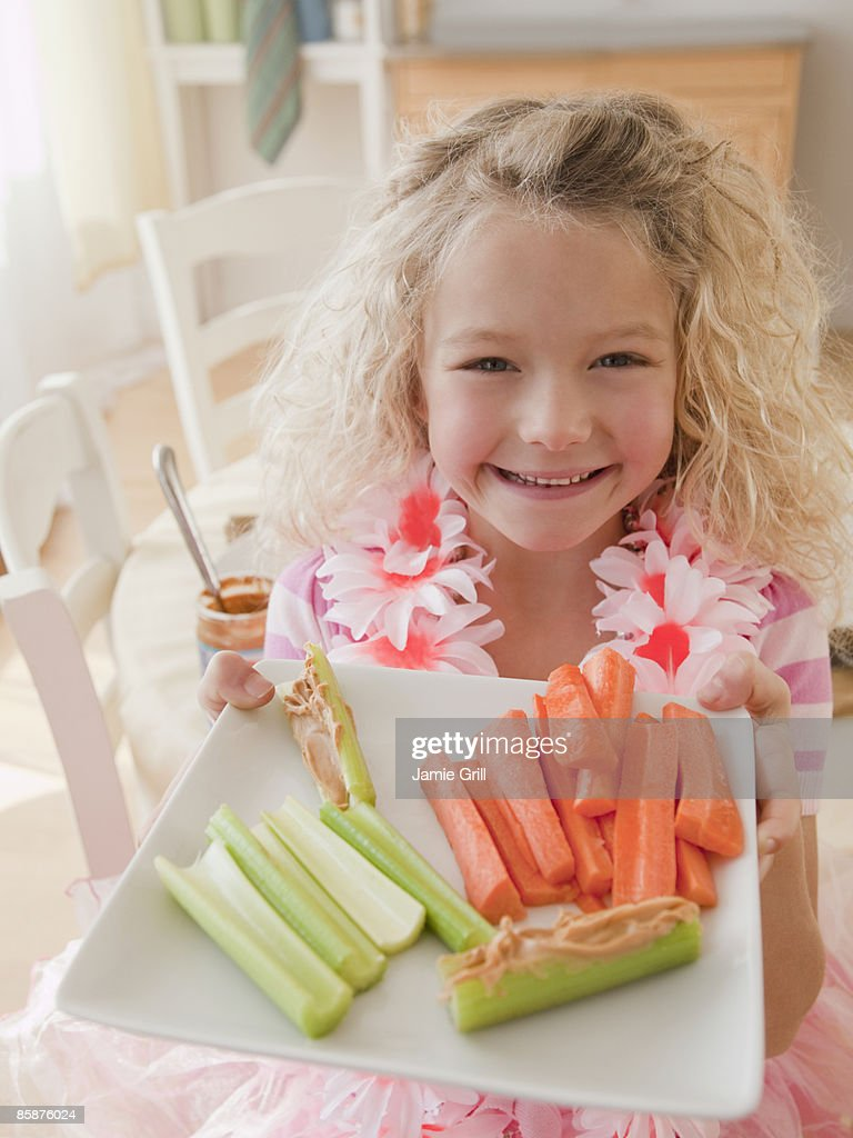 Young Girl With Healthy Snack, Smiling : Stock Photo