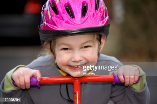 Young Girl with Helmet on a scooter