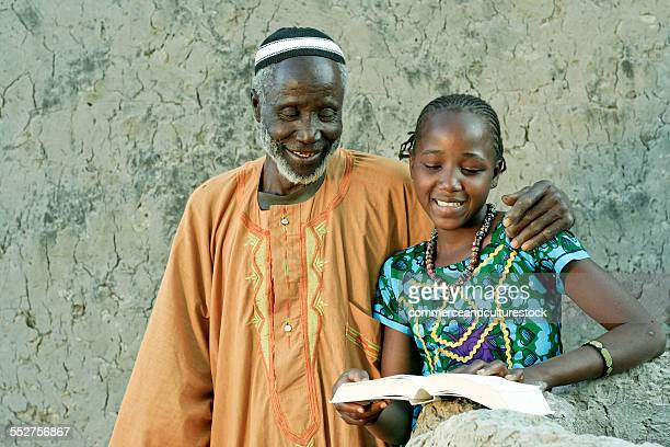 A young girl with her grandfather