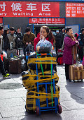 A young girl with her heavy luggage waits on the square of Beijing west railway station China's 40day spring travel rush called 'chunyunthe largest...