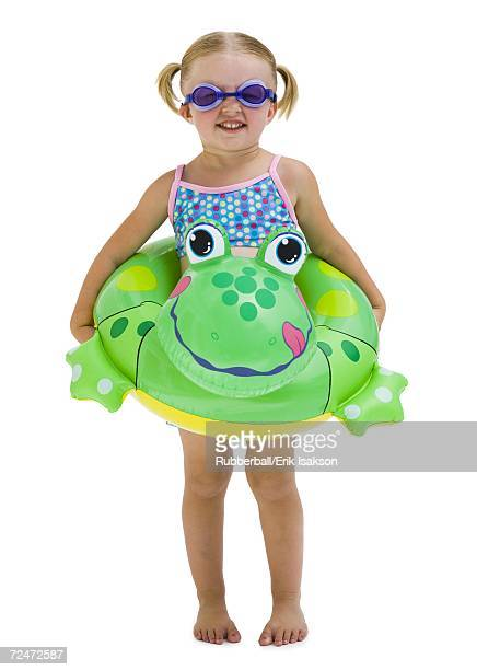 Young girl with inflatable flotation device around waist
