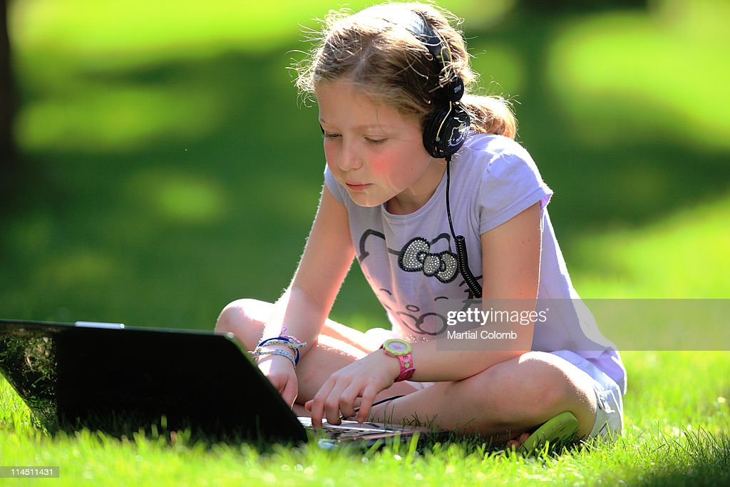 Young girl with laptop and headphones : Stock Photo