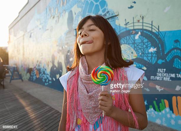 young girl with lollipop on the boardwalk