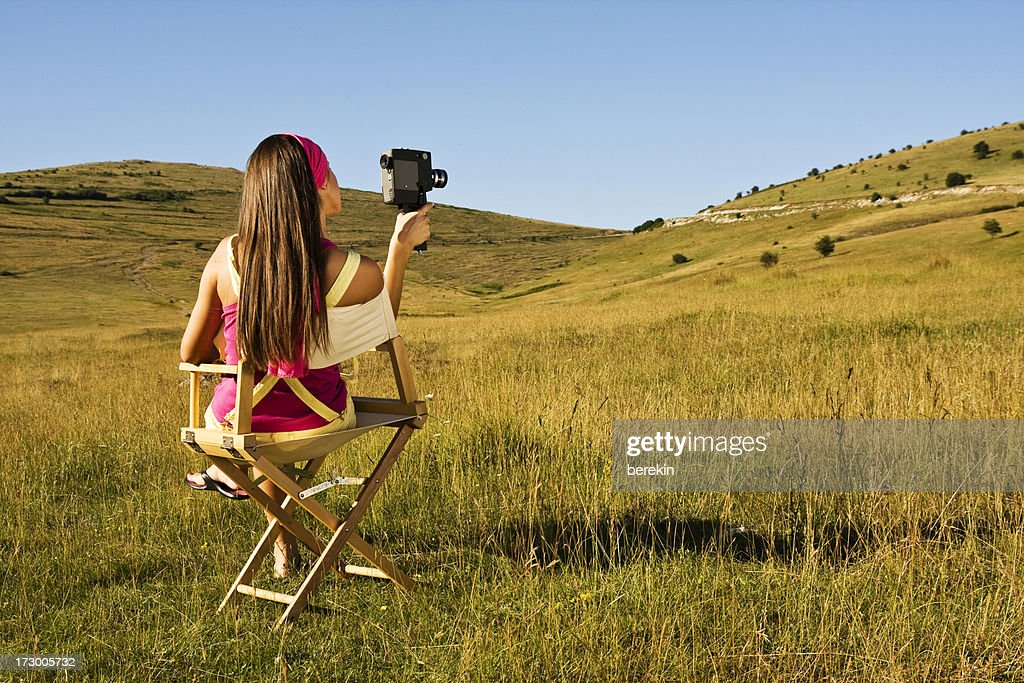 young girl with movie cam