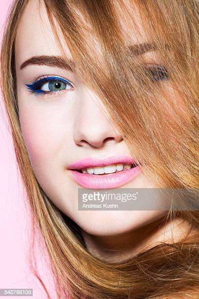 Young girl with pink lipstick, close up.