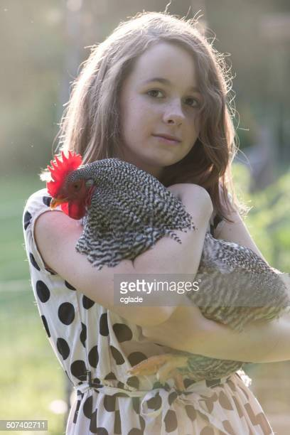 Young Girl with Prize Pet Rooster