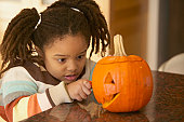 Young girl with pumpkin