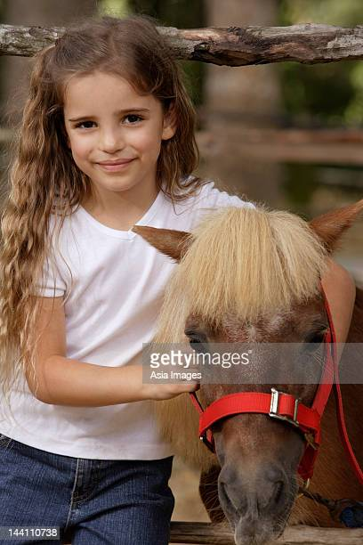 young girl with Shetland pony