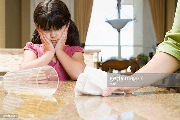 Young girl with spilled orange juice