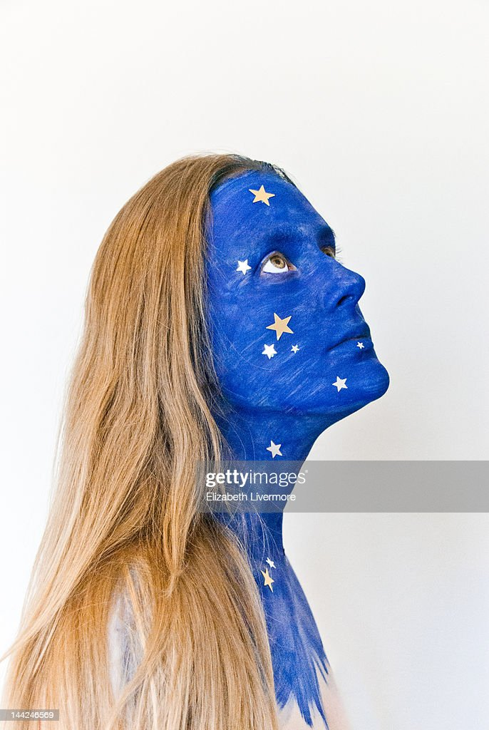 Young girl with stars painted on her face : Stock Photo