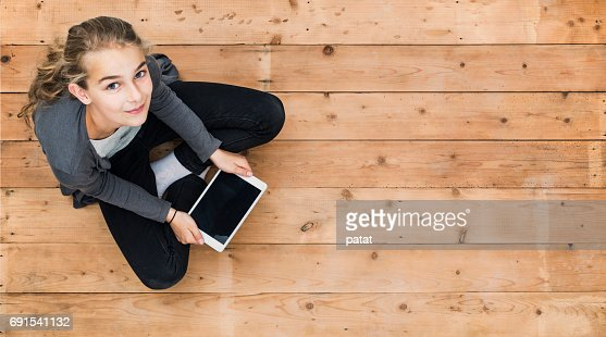 Young girl with tablet header mockup : Stock Photo