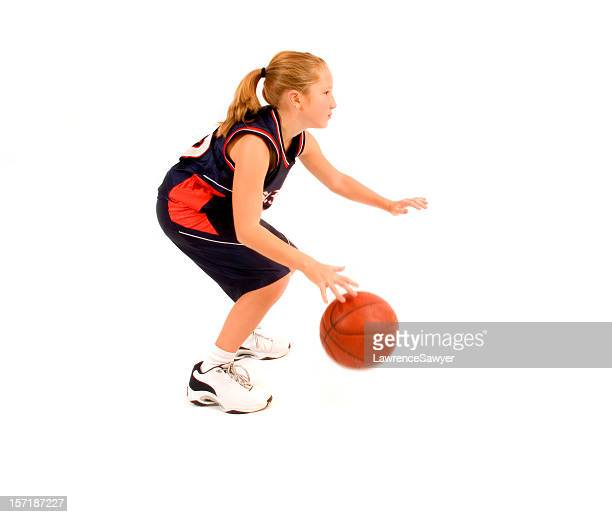 Young girl with team jersey playing Junior high basketball
