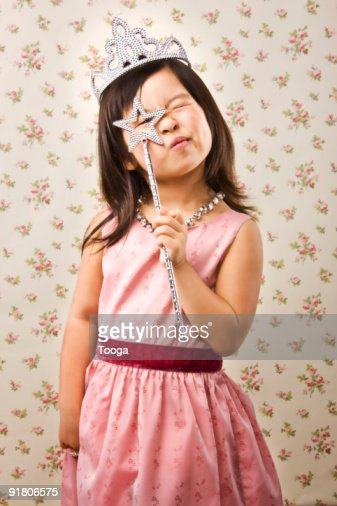 Young girl with tiara and magic wand : Stock Photo