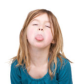 Portrait of a young girl with tongue out isolated on white background
