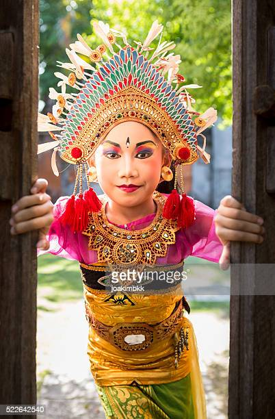 Young girl with traditional costume in a Bali temple