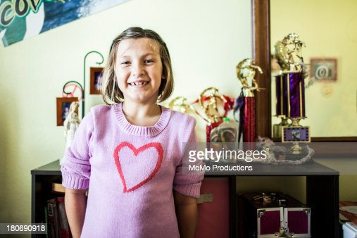 Young girl (11) with trophies : Stock Photo