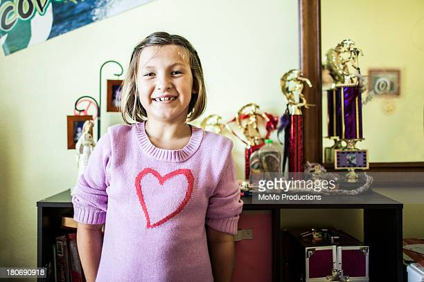Young girl (11) with trophies