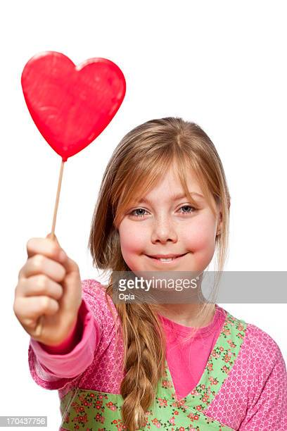 Young girl with valentine heart candy