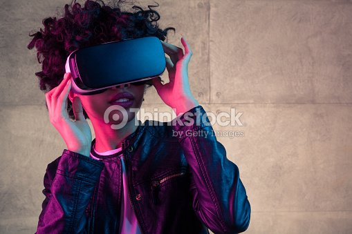 Young girl with VR goggles on head : Stock Photo