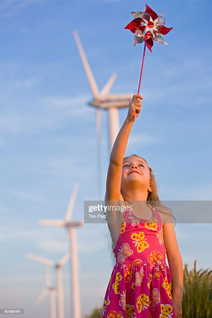 Young girl with windmills : Stock Photo