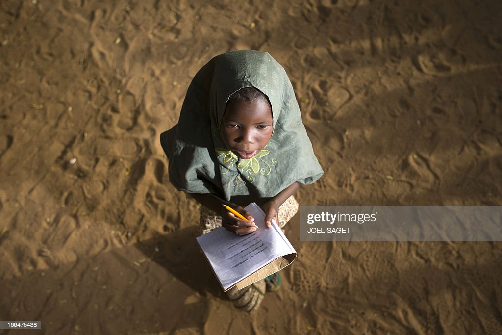 A young girl writes during a lesson at Thionville Chateau school in Gao, Mali on April 12, 2013.