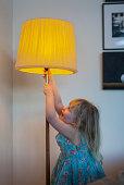 young girl/child w lit floor lamp