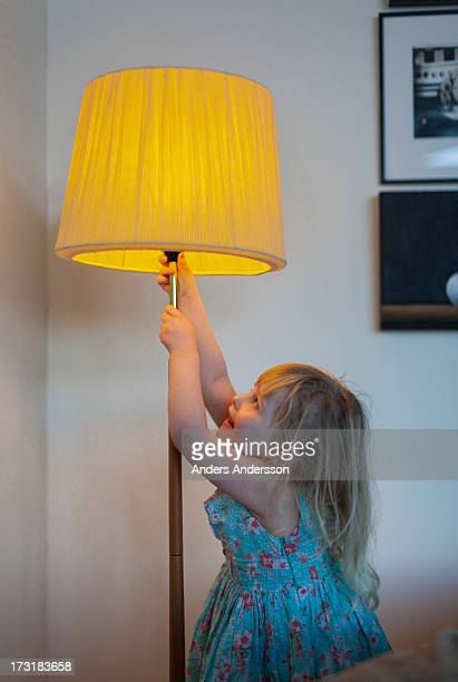 young girl/child w lit floor lamp