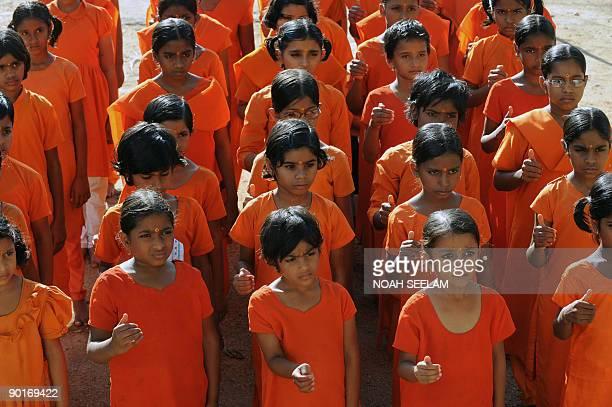 Young girls aspiring to become priests are seen at the Pani Prabhata Kanya Maha Vidyalayam in the outskirts of Hyderabad on August 29 2009 Acharya...