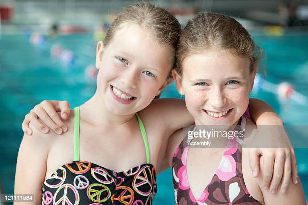 Young girls at swimming pool, portrait
