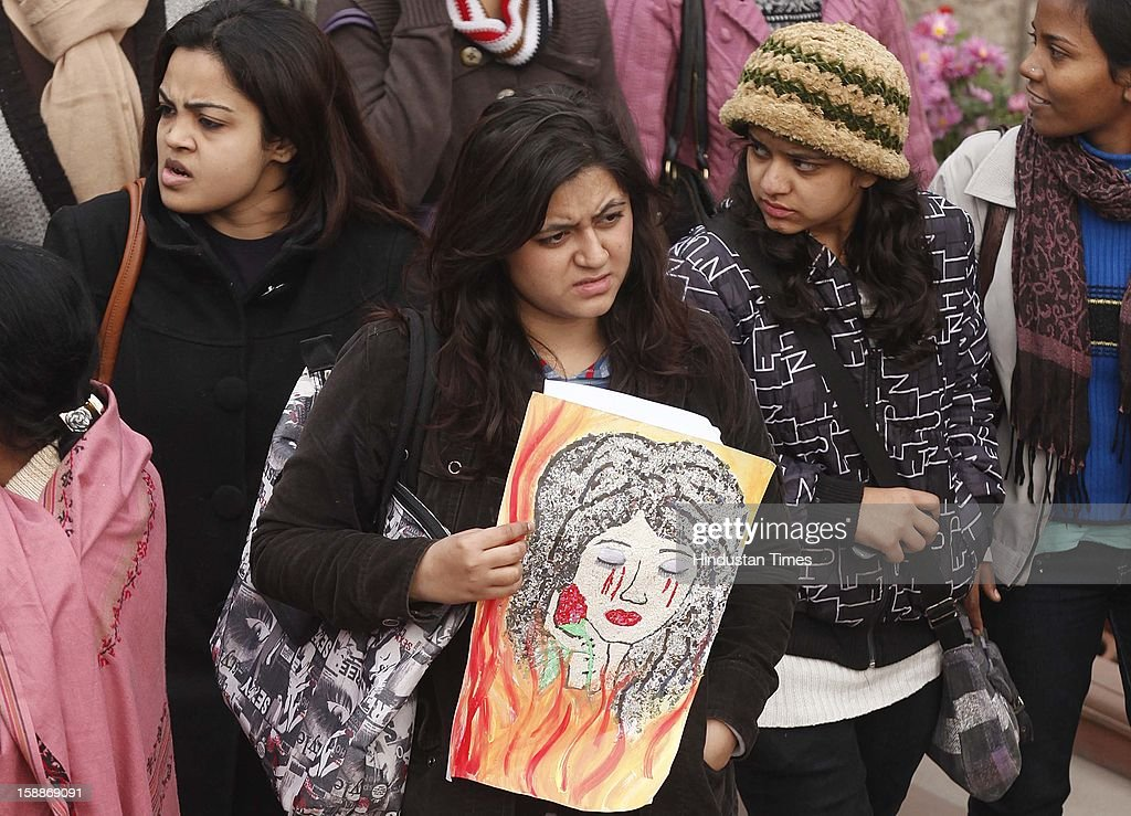 A Young Girls attend a prayer ceremony for a rape victim after a rally, organized by Delhi Chief Minister Sheila Dikshit (unseen), protesting for justice and security for women at Raj Ghat on January 2, 2013 in New Delhi, India. Dikshit flagged off the 'Mahila Suraksha Samman March' from Bal Bhavan to Rajghat which was participated by over a thousand women.