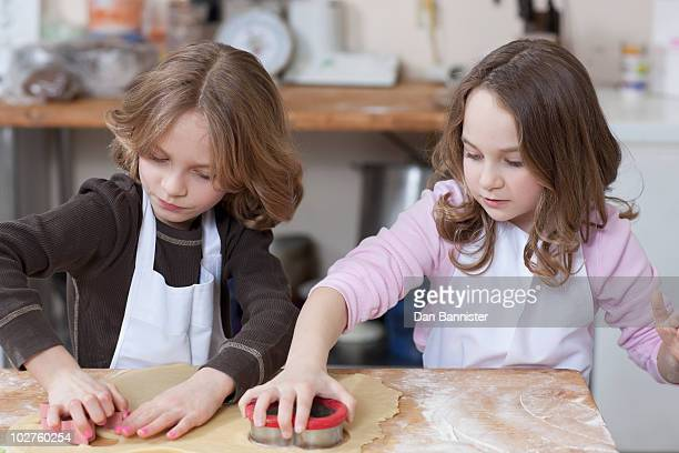 Young girls baking cookies