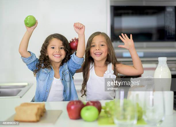 Young girls cooking at home
