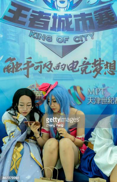 Young girls cosplay as the main characters of the mobile game Arena of Valor Arena of Valor 5v5 Arena Game China's most popular mobile game developed...