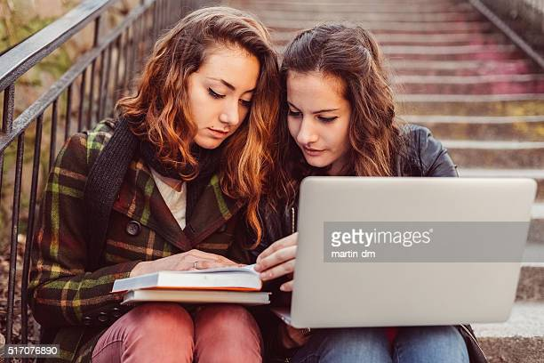Young girls doing the homeworks together