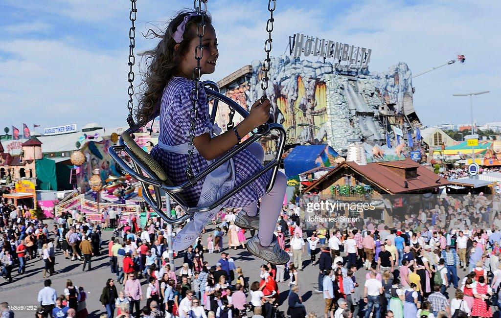 A young girls dressed in traditional Bavarian clothing enjoys riding a merry-go-round during day 15 of Oktoberfest beer festival on October 6, 2012 in Munich, Germany. This year's edition of the world's biggest beer festival Oktoberfest will run until October 7, 2012.