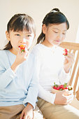 Young Girls eating strawberries