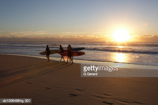 Young girls enjoy an early morning surf on Surfers Paradise Beach, the Gold Coast, Queensland, Australia  : Stock Photo