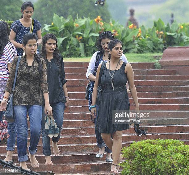 Young girls enjoy first monsoon shower that hits on June 16 2013 in New Delhi India The national capital has been witnessing premonsoon showers...