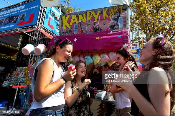 Young girls enjoy ice drinks during the Sydney Royal Easter Show on March 22 2013 in Sydney Australia Organisers are expecting over 900000 visitors...
