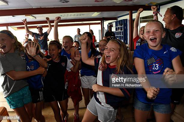 Young girls from the Colorado Rush organization cheer as the USA women's team beats Japan in the finals of the World Cup soccer match in Littleton...