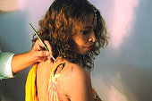 Young girls getting themselves tattooed in special garba designs ahead of the Navratri festival on October 12 2015 in Bhopal India Garba is a popular...