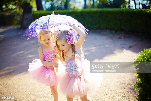 young girls in tutus in park