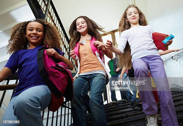 Young girls leaving for home from school