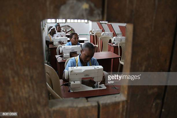 Young girls make uniforms on sowing machines donated by international organizations to people displaced by violence on April 18 at Pedro Grau school...