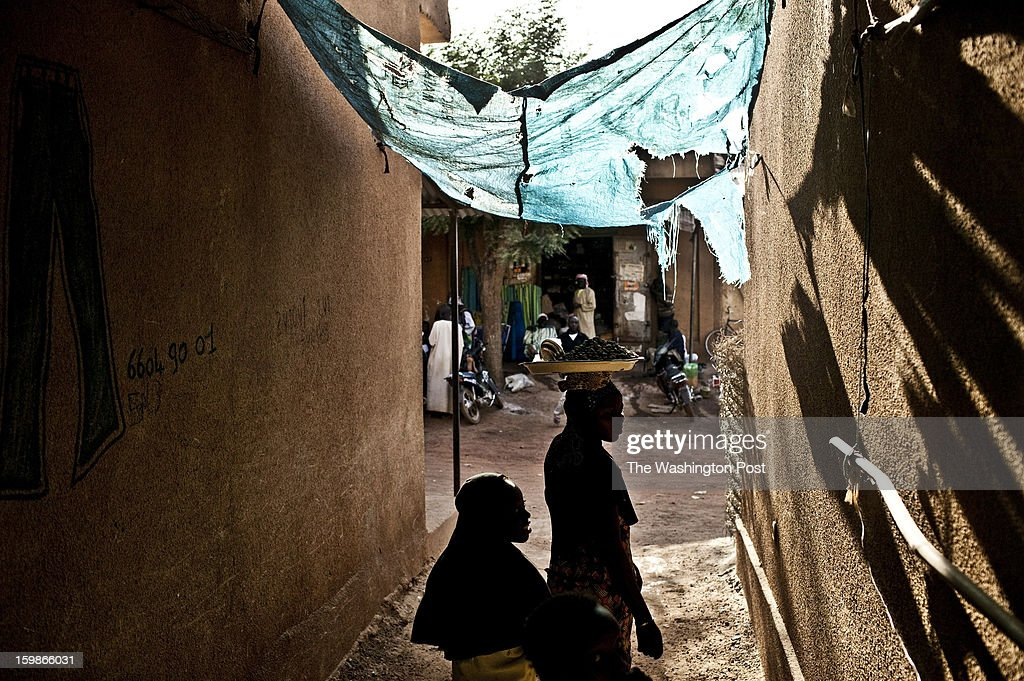 Young girls pass through alleys in the town of Banamba, approximately 90 miles north of the capital of Bamako, on Friday January 18, 2013. Fear among residents in Banamba spread on Thursday amid rumors that Islamist fighters had entered the town.