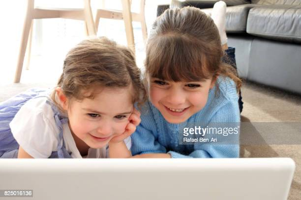 Young girls play with a program on wireless device