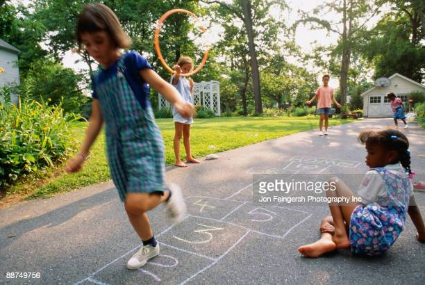Young girls playing hopscotch