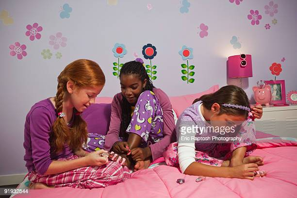 Young girls playing in bedroom
