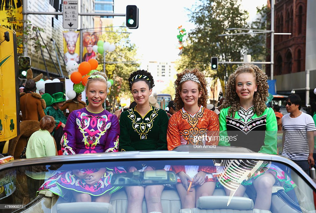 Young girls pose from inside a car prior to marching in the parade on March 16, 2014 in Sydney, Australia. St Patrick's Day is an annual religious and cultural commemoration of the widely recognised patron saint of Ireland, Saint Patrick. March 17th, is a public holiday in Northern Ireland and the Republic of Ireland but is celebrated in many countries around the world where Irish diaspora have settled.