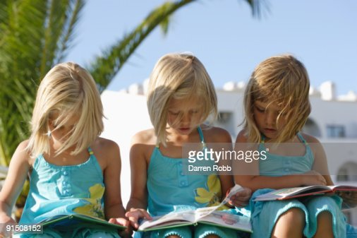 Young girls reading : Stock Photo